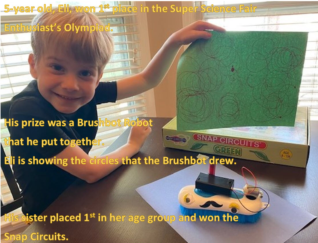 Eli Winning the Brushbot in the K-2 grade Super Science Fair Enthusiast's Olympiad